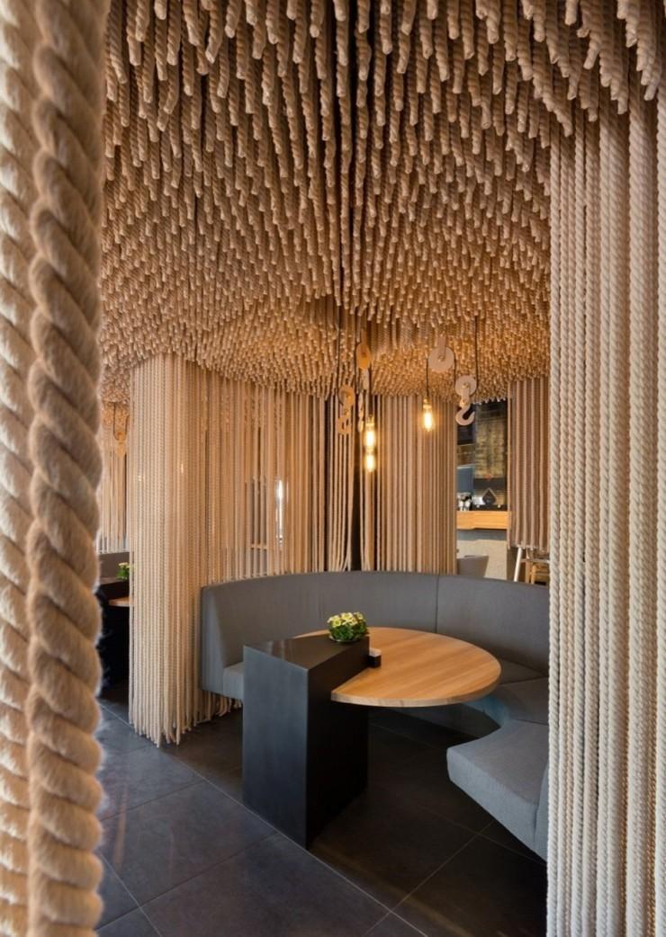 """""""Odessa invita a sus huéspedes en un formato completamente nuevo.""""  Decoración de Interiores: Restaurant Odessa de YOD Design Lab 63"""
