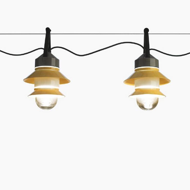 """""""La colección Santorini puede colocarse suspendida en el techo sola o en composiciones, o colgarse a modo de guirnalda""""  Santorini: la colección de luminarias outdoor de Marset Santorini garland mustard"""