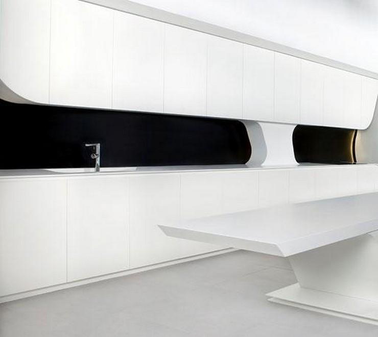 """""""Diseñada en blanco, aunque también puede adquirirse en negro y gris combinado con blanco.""""  Cocina futurista diseñada por A-cero un nuevo concepto cocina wave gunni trentino"""